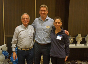 Fraij Yapoujian (left) and Elise Vaughn of Reliable Equipment Sales Meet Finish Thompson CEO Casey Bowes at the annual FTI educational conference.